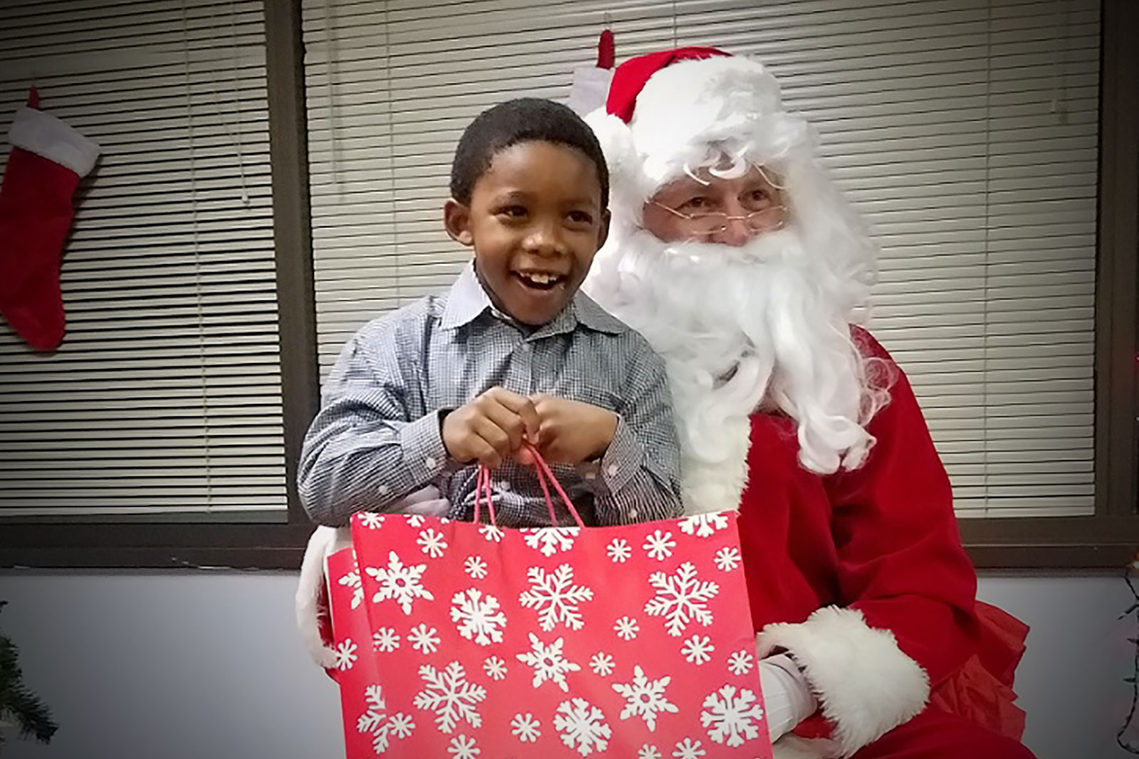 a very happy little boy meeting Santa Claus